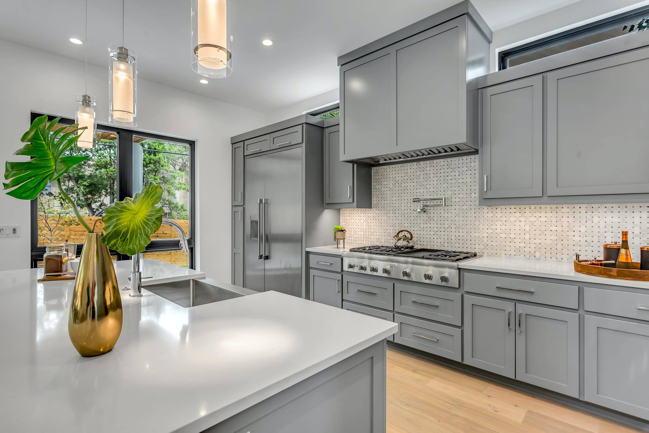 Kitchen remodel in Grey tones with Quartz counters.